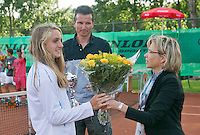 August 9, 2014, Netherlands, Rotterdam, TV Victoria, Tennis, National Junior Championships, NJK,  Prize giving, Richard Krajicek with Isolde de Jong, winner girls 14 years receives flowers from Petra Hermans-Verloop<br /> Photo: Tennisimages/Henk Koster