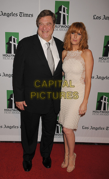 John Goodman, Kelly Reilly.16th Annual Hollywood Film Awards Gala held at the Beverly Hilton Hotel, Beverly Hills, California, USA..October 22nd, 2012.full length white shirt grey gray tie black suit lace sleeveless dress .CAP/ROT/TM.©Tony Michaels/Roth Stock/Capital Pictures