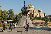 Armenia. Yerevan. Men and women walk in front of the Saint Gregory the Illuminator Cathedral and the equestrian statue of Andranik. The Saint Gregory the Illuminator Cathedral, also known as the Yerevan Cathedral is currently the largest cathedral of the Armenian Apostolic Church in the world. The Armenian Apostolic Church is the national church of the Armenian people. Part of Oriental Orthodoxy, it is one of the most ancient Christian communities. Andranik Ozanian, commonly known as Andranik (25 February 1865 – 31 August 1927) was an Armenian military commander and statesman, the best known fedayi and a key figure of the Armenian national liberation movement. From the late 19th century to the early 20th century, he was one of the main Armenian leaders of military efforts for the independence of Armenia. Yerevan, sometimes spelled Erevan, is the capital and largest city of Armenia. 10.10.2019 © 2019 Didier Ruef