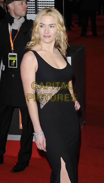 KATE WINSLET.Arrivals at the Orange British Academy Film Awards 2010 at the Royal Opera House, Covent Garden, London, England..February 21st, 2010.BAFTA BAFTAs half length black sleeveless lace insert sides dress panel panels maxi bracelet .CAP/CAN.©Can Nguyen/Capital Pictures.