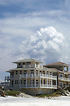 Thunderhead clouds provide a spectacular backdrop for a specatular beach house.