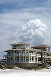 Thunderhead clouds provide a spectacular backdrop for a specatular beach house.