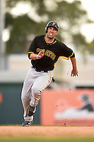 First baseman Travis Ishikawa (3) of the Pittsburgh Pirates during a spring training game against the Baltimore Orioles on March 23, 2014 at McKechnie Field in Bradenton, Florida.  Baltimore and Pittsburgh played to a 7-7 tie.  (Mike Janes/Four Seam Images)