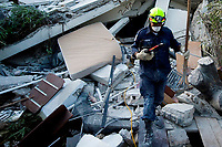 100114-N-6266K-090, Port-au-Prince,  (Jan. 14, 2010) - Members of Fairfax County Urban Search and Rescue conduct  a rescue operation at the Montana Hotel in Port-au-Prince, Haiti. The all volunteer service partnered with U.S. Agency for International Development (USAID) and multi-national relief agencies to support the massive relief efforts needed in the aftermath of Tuesday's earthquake. Eight personnel, including 7 Americans, have been rescued from the rubble of the hotel.  (U.S. Navy Photo by Mass Communication Specialist First Class Joshua Lee Kelsey)