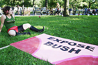 "A woman bares some skin as part of a ""Mass Flash"" organized by the group Axis of Eve in Battery Park in New York City on September 1, 2004 during the Republican National Convention.  The purpose of the ""mass flash"" according to Axis of Eve was to ""create a media spectacle that lays bare the shameful tactics of the Bush administration and boldly demands an end to political cover-up."" ."