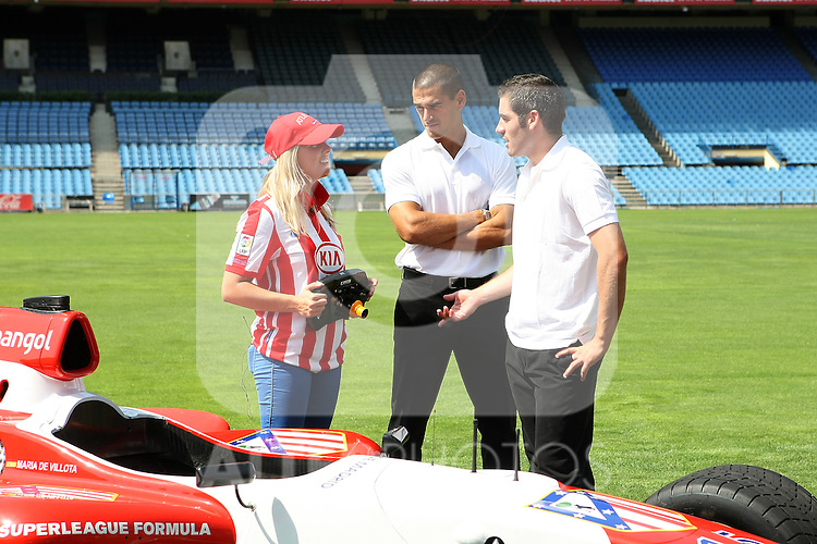 Atletico de Madrid's Superleague Formula new pilot Maria de Villota (l) and the players Antonio Lopez (r) and Juanito Rodriguez. September 01 2009. (ALTERPHOTOS/Acero).