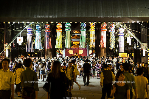 Visitors enjoy the display of lanterns during the annual ''Mitama Festival'' at Yasukuni Shrine on July, 13, 2015, Tokyo, Japan. Over 30,000 lanterns line the entrance to the shrine to help spirits find their way during the annual celebration for the spirits of ancestors. The festival is held from July 13th to 16th. (Photo by Rodrigo Reyes Marin/AFLO)