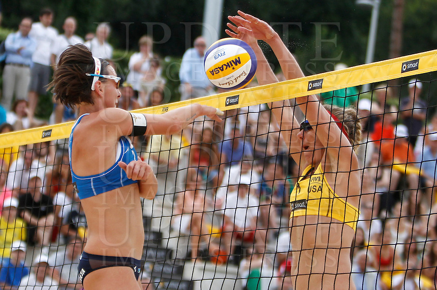 Italy's Greta Cicolari in action against April Ross, of the United States, right, at the Beach Volleyball World Tour Grand Slam, Foro Italico, Rome, 22 June 2013. United States defeated Italy 2-0.<br /> UPDATE IMAGES PRESS/Isabella Bonotto