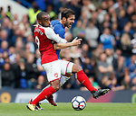 Cesc Fabregas of Chelsea tackled by Alexandre Lacazette of Arsenal during the premier league match at Stamford Bridge Stadium, London. Picture date 17th September 2017. Picture credit should read: David Klein/Sportimage