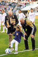 Vice President of the United States Joe Biden watches his granddaughter Natalie take the ceremonial first kick as hall of fame soccer player Walter Bahr watches prior to the game. The Philadelphia Union defeated D. C. United 3-2 during a Major League Soccer (MLS) match at Lincoln Financial Field in Philadelphia, PA, on April 10, 2010.