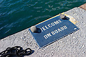 "Santorini, Greece. 05.05.2014. A doormat, bearing the legend ""Welcome on Board"", by a mooring in the harbour, Vlychada, Santorini, Greece. Photograph © Jane Hobson."