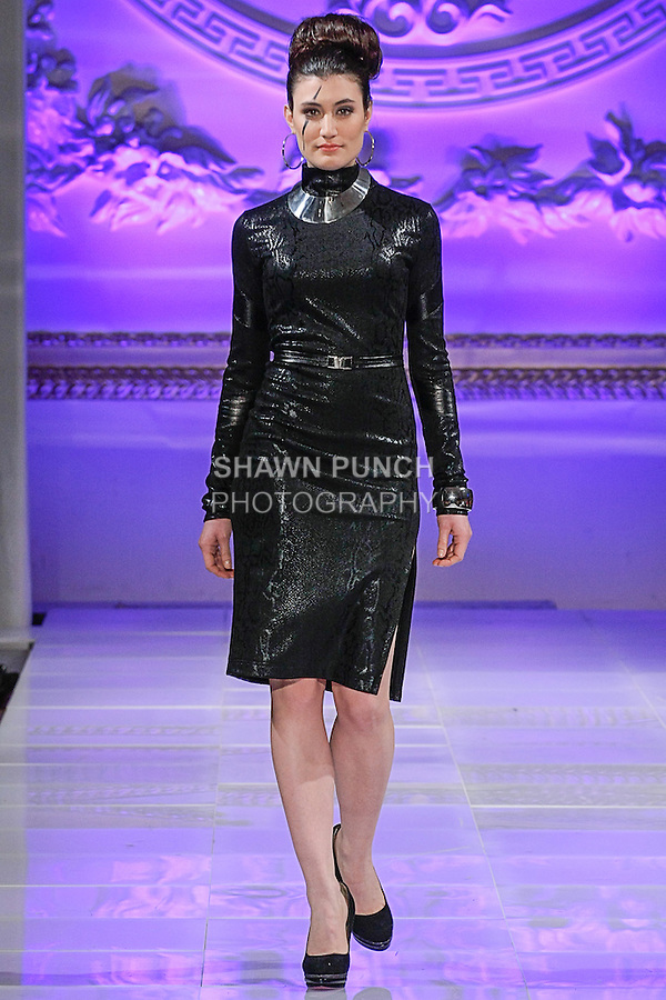 Model walks runway in an outfit from the Fall 2013 Tyrell Collection by Tyrell Mason, during Couture Fashion Week New York Fall 2013, on 02/17/13.