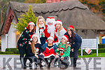 Staff of Deenagh Lodge and Kerry Down Syndrome who are running Deenagh Lodge this year and will receive all the proceeds. Pictured Claire Mc Carthy, Aoife O'Mahony, Keelin O'Sullivan, Santa, Janette O'Donoghue, Nakita Burke, Ciara O'Mahony and Aisling Collins.