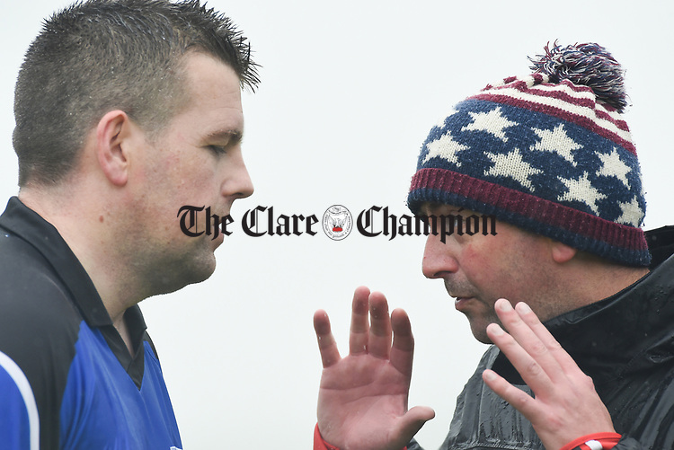 Brian Conway, manager of St Breckan's, talks to referee John Hannon during their first round senior championship game against Miltown Malbay in Ennistymon. Photograph by John Kelly