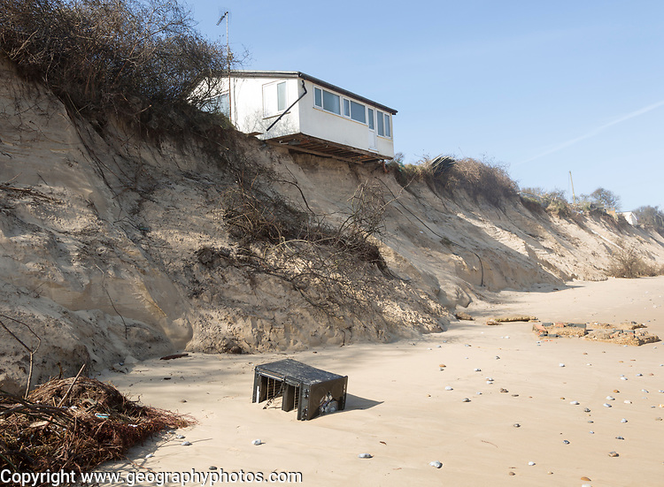 March 2018, Clifftop property collapsing due to coastal erosion after recent storm force winds, Hemsby, Norfolk, England, UK