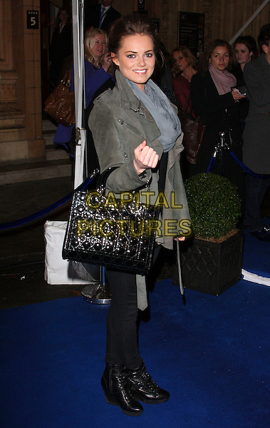 KARA TOINTON .UK Premiere of Cirque du Soleil's 'Totem' at the Royal Albert Hall, London, England, UK, January 5th 2011..Full length black grey gray bag jacket scarf leather suede Dior hand bag leggings boots side wedges .CAP/ROS.©Steve Ross/Capital Pictures