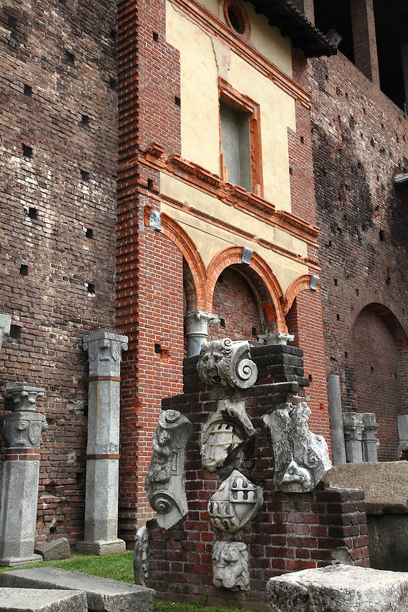 Milano: A piece of wall in which are inserted parts of ancient sculptures in the arms&rsquo; courtyard of the Sforza&rsquo;s ducal castle.<br />