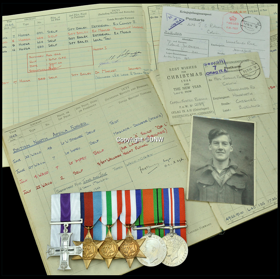 BNPS.co.uk (01202 558833)<br /> Pic: DNW/BNPS<br /> <br /> Captain Foster Robson's medals and log book's.<br /> <br /> For Sale - The medals of a remarkable RAF glider pilot who survived numerous close shaves before finally being shot and captured at Arnhem.<br /> <br /> The remarkable story of a wartime pilot who landed his glider in the sea, swam ashore, marched 10 miles and helped capture two enemy pillboxes while unarmed has emerged.<br /> <br /> Captain Foster Robson cheated death numerous times during Operation Husky, the Allied invasion of Sicily in 1943 and Arnhem in 1944.<br /> <br /> He watched numerous colleagues either drown in the sea or be cut down by machine gun fire after 144 wooden gliders carrying troops ditch off-shore.<br /> <br /> He expertly guided the aircraft to just 250 yards from the beach, allowing him, his co-pilot and two army officers to make it to shore.<br /> <br /> He received a Military Cross for his actions in Sicily and his medals are now being sold by auctioneers Dix Noonan Webb.