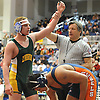 Zach Kornberg of Lynbrook, left, raises his arm after defeating Luis Campos of Great Neck South by major decision 8-0 at 182 pounds in the Nassau County Division 1 wrestling quarterfinals at Hofstra University on Saturday, Feb. 13, 2016.