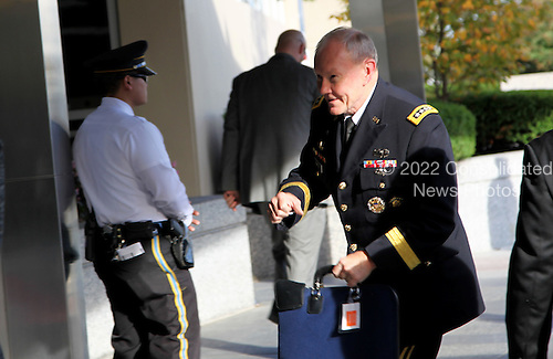 Chairman of the Joint Chiefs of Staff, Martin Dempsey, leaves the State Department after meeting with US President Barack Obama, Vice President Joe Biden and other members of the National Security Council to discuss the campaign to combat ISIL at the State Department in Washington DC, on October 24, 2014.<br /> Credit: Aude Guerrucci / Pool via CNP