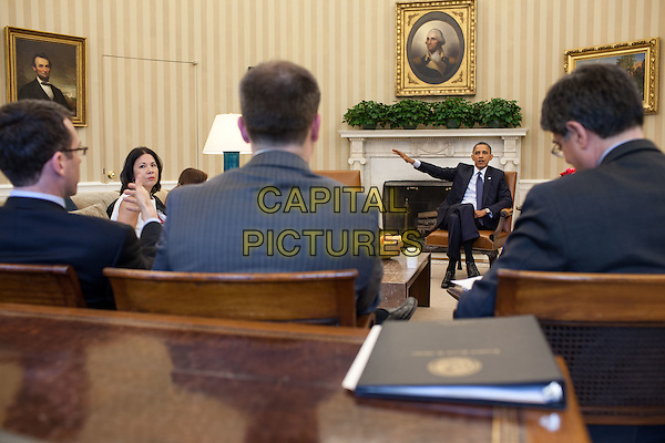 United States President Barack Obama meets with senior advisors in the Oval Office, April 19, 2012.  .full length blue suit sitting arm.CAP/ADM/PS.©Pete Souza/CNP/AdMedia/Capital Pictures.