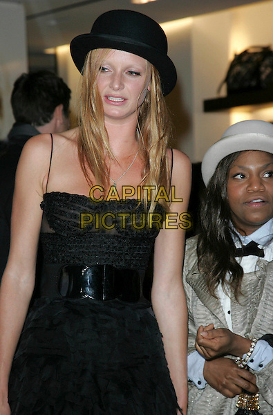 OLIVIA INGE.Vogue 'Fashion's Night Out ' launch at Burberry's store in New Oxford Street, London, England..September 10th 2009.half length black sheer frills ruffled ruffles dress hat belt.CAP/ROS.©Steve Ross/Capital Pictures.