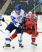 Joonas Nättinen (Finland - 18), Stanislav Kalashnikov (Russia - 4) - Russia defeated Finland 4-0 at the Urban Plains Center in Fargo, North Dakota, on Friday, April 17, 2009, in their semi-final match during the 2009 World Under 18 Championship.