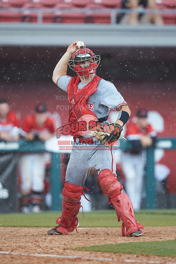 North Carolina State Wolfpack catcher Patrick Bailey (5) makes a throw to first base against the Northeastern Huskies at Doak Field at Dail Park on June 2, 2018 in Raleigh, North Carolina. The Wolfpack defeated the Huskies 9-2. (Brian Westerholt/Four Seam Images)