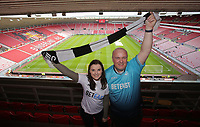 Swansea supporters hold a scarf prior to the Premier League match between Sunderland and Swansea City at the Stadium of Light, Sunderland, England, UK. Saturday 13 May 2017
