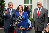 Speaker of the United States House of Representatives Nancy Pelosi (Democrat of California), center, speaks to reporters at the White House in Washington, DC after a meeting with US President Donald J. President Donald J. Trump  on Wednesday, October 16, 2019.  At left is US Senate Minority Leader Chuck Schumer (Democrat of New York) and at right is US House Majority Leader Steny Hoyer (Democrat of Maryland).<br />