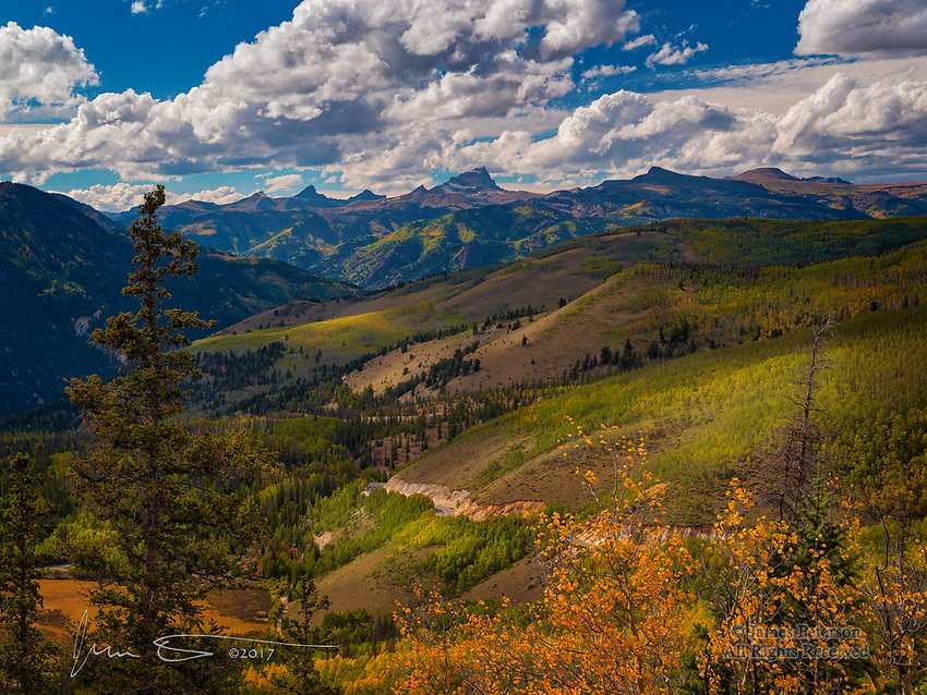 Near Slumgullion Pass, Colorado ©2017 James D Peterson.  We went through this area in mid-September, when the fall foliage was just beginning to appear.  This view is above Lake City as Highway 149 ascends towards its highest point, 11,530 feet (3,514 m) above sea level.  The views of the San Juan Mountains are spectacular along thsi route.