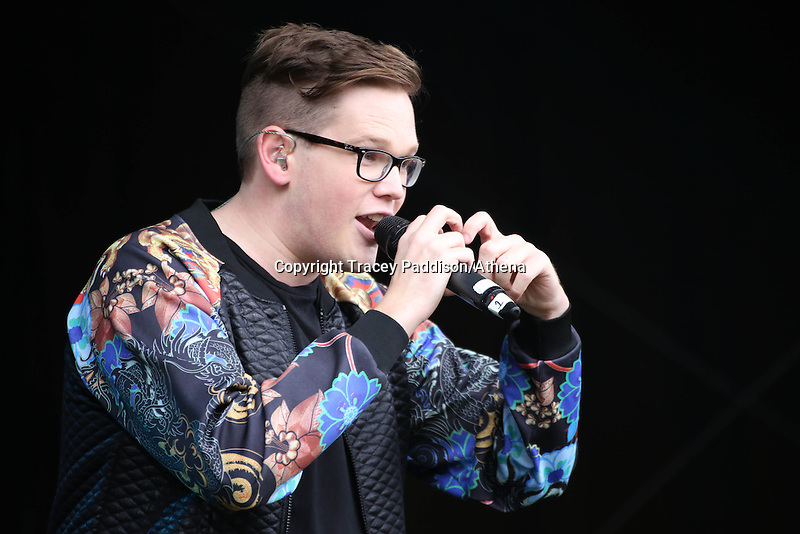 Saturday August 16, 2014 <br /> Picture: Tom Barnwell<br /> RE: The Voice UK's Tom Barnwell performing on stage at Pride Cymru in Coopers Field, Cardiff, South Wales.
