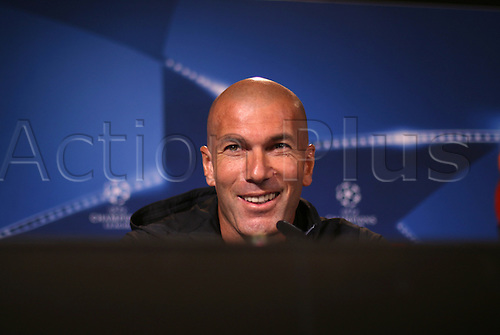 26.09.2016. Dortmund, Germany.  Real Madrid's coach Zinedine Zidane smiles during a press conference in Dortmund, Germany, 26 September 2016. Borussia Dortmund plays  against Real Madrid in the in Champions League on 27 September 2016.