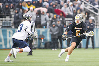 Washington, DC - February 23, 2019: Towson Tigers Jake McLean (6) runs pass a Georgetown Hoyas defender during game between Towson and Georgetown at  Cooper Field in Washington, DC.   (Photo by Elliott Brown/Media Images International)