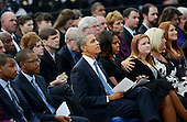 United States President Barack Obama and first lady Michelle Obama reflect at a memorial for the victims of the Washington Navy Yard shooting at the Marine Barracks, September 22, 2013 in Washington, D.C. The President and First Lady also visited with families of the victims. <br /> Credit: Olivier Douliery / Pool via CNP