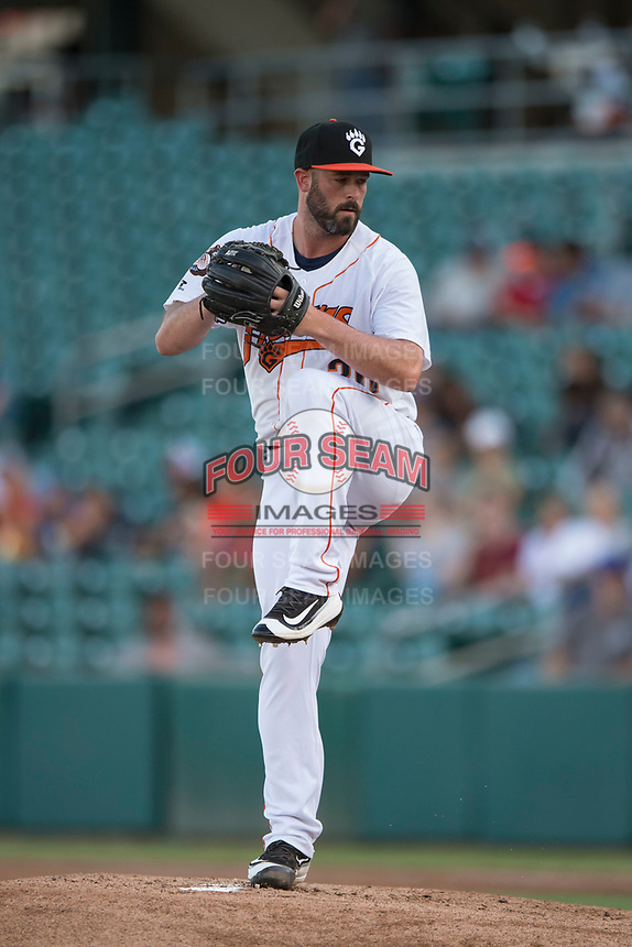 Fresno Grizzlies starting pitcher Mike Hauschild (30) prepares to deliver a pitch during a Pacific Coast League game against the Salt Lake Bees at Chukchansi Park on May 14, 2018 in Fresno, California. Fresno defeated Salt Lake 4-3. (Zachary Lucy/Four Seam Images)