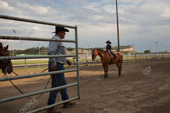 Stock contractors prepare for the rodeo at the Montana Fair. Bilings, Montana, USA, August 13, 2009