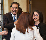DePaul President A. Gabriel Esteban, Ph.D., and his wife Josephine share a laugh with a group of women leaders during a reception Thursday, July 20, 2017, at The Chicago Club. The event was organized to welcome the Estebans to Chicago and introduce them to some of Chicago&rsquo;s most influential women. <br /> (DePaul University/Jamie Moncrief)