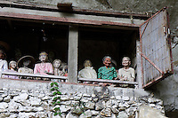cemetery outside a cave with effigie puppets called Tau Tau representing the deceased ancestor in Toraja land, Sulawesi, Indonesia.