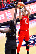 Washington, DC - September 2 2018: Washington Mystics forward Elena Delle Donne (11) hits a three pointer over Atlanta Dream center Elizabeth Williams (1) during semifinals game against Atlanta Dream. Mystics even the series and force a deciding game 5 in Atlanta with a 97-76 win at the Charles Smith Center at George Washington University in Washington, DC. (Photo by Phil Peters/Media Images International)