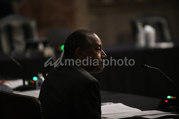 United States Secretary of Housing and Urban Development (HUD) Ben Carson, listens to questions of U.S. Senators on Capitol Hill in Washington, D.C., June 9, 2020, during a hearing of the U.S. Senate Committee on Banking, Housing, and Urban Affairs to examine housing regulations during the pandemic.<br /> Credit: Astrid Riecken / Pool via CNP/AdMedia