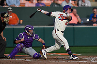 Left fielder Robert Jolly (12) of the Clemson Tigers bats in a game against the Furman Paladins on Tuesday, February 20, 2018, at Doug Kingsmore Stadium in Clemson, South Carolina. The catcher is Logan Taplett; the umpire is Darion Padgett. Clemson won, 12-4. (Tom Priddy/Four Seam Images)