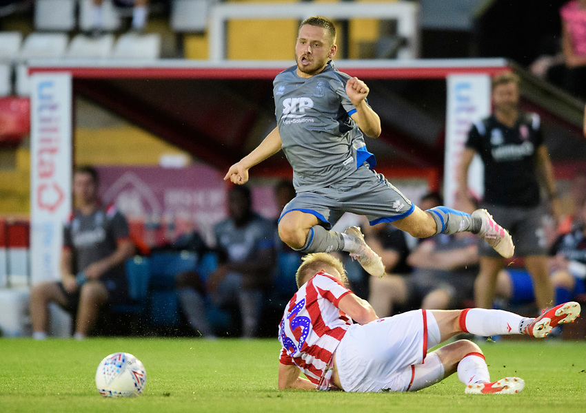 Lincoln City's Jack Payne is fouled by Stoke City's Lasse Sorensen<br /> <br /> Photographer Chris Vaughan/CameraSport<br /> <br /> Football Pre-Season Friendly - Lincoln City v Stoke City - Wednesday July 24th 2019 - Sincil Bank - Lincoln<br /> <br /> World Copyright © 2019 CameraSport. All rights reserved. 43 Linden Ave. Countesthorpe. Leicester. England. LE8 5PG - Tel: +44 (0) 116 277 4147 - admin@camerasport.com - www.camerasport.com