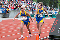 Oran's Ashlyn McIntosh hands the baton to teammate Sydney Kern as the Eagles went on to finish 11th in the Class 1 4x200 relay, in 1:54.14.
