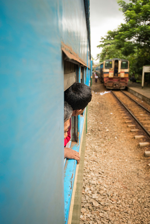 """The British-built Circle Line began operations in 1959 and currently serves over 20,000 passengers each day.<br /> <br /> <br /> <br /> The sometimes achingly slow three-hour train ride passes through 39 stations, connecting satellite towns and suburban areas to the city of Yangon. <br /> <br /> <br /> Objectively, the Circle Line train cars are far from comfortable with unaccommodating chairs, bad suspension, and open-air compartments that expose riders to rain, insects, and sometimes sweltering heat. <br /> <br /> <br /> However, despite all these apparent discomforts, the Circle Line Train is a fantastic way to connect in close quarters with the exceptionally friendly and open Burmese people -- always ready to offer their seat to a stranger in need -- a large sign is mounted in every car proclaiming: """"Warmly welcome and take care of tourists.""""  <br /> <br /> To ride the Circle Line is to experience the quotidien intimacies of Yangon's people as they journey together, sharing food and conversation with a greater ease and conviviality than is likely to be found on any Western train. <br /> <br /> <br /> <br /> <br /> And because the Circle Line train offers the region's cheapest daily commuting option, it offers even the lowest level of Burmese wage earners affordable transportation to their jobs in Yangon."""