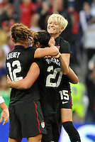Lauren Cheney (12) and Megan Rapinoe (15) celebrate Abby Wambach's opening goal.....USWNT played to a 1-1 tie with Canada at LIVESTRONG Sporting Park, Kansas City, Kansas.