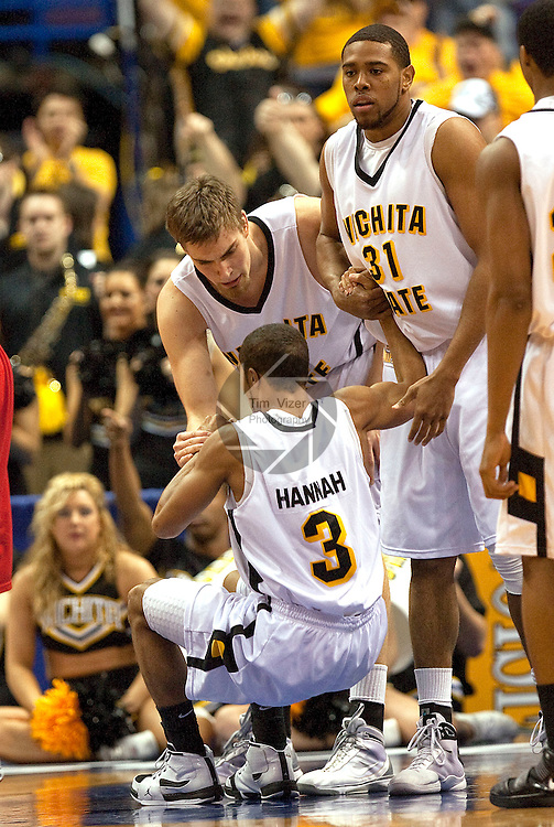 March 6,  2010            Wichita State center Garrett Stutz (41) and Wichita State forward/center J.T. Durley (31) help teammate Wichita State guard Clevin Hannah (3) up after he was knocked down by an Illinois State player in the first half.  Wichita State defeated Illinois State by a score of 65-61 in the second of two semifinals played on Saturday March 6, 2010 at the Missouri Valley Conference Tournament.  The tournament is being held at the Scottrade Center in downtown St. Louis.  Wichita State advances to play the University of Northern Iowa for the MVC Tournament Championship.  The winner earns an automatic berth in the NCAA Tournament.