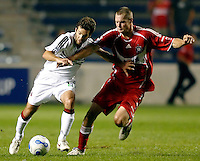 DC United midfielder Ben Olsen (14) and Chicago Fire forward Nate Jaqua (11) battle for the ball.  The Chicago Fire defeated the DC United 3-0 in the semifinals of the U.S. Open Cup at Toyota Park in Bridgeview, IL on September 6, 2006...