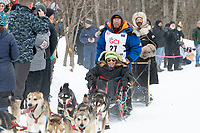 Mitch Seavey and team run past spectators on the bike/ski trail near University Lake with an Iditarider in the basket and a handler during the Anchorage, Alaska ceremonial start on Saturday, March 7 during the 2020 Iditarod race. Photo © 2020 by Ed Bennett/Bennett Images LLC