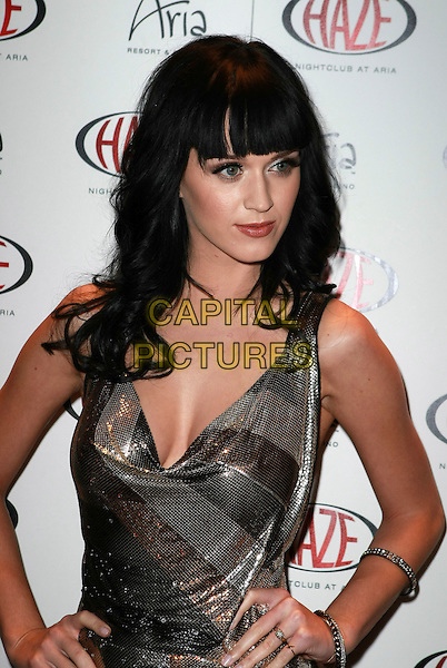 KATY PERRY.Katy Perry to Host Waking Up in Vegas Party at Haze Nightclub at Aria Resort Hotel and Casino, Las Vegas, Nevada, USA, 23rd January 2010..half length  silver shiny dress brown bracelets chainmail chain mail  sleeveless hands on hips cleavage fringe .CAP/ADM/MJT.©MJT/Admedia/Capital Pictures